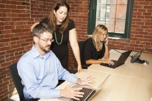 coworkers on laptops in digital workplace